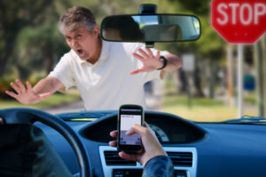 Irresponsible texting and driving wreck hitting pedestrian